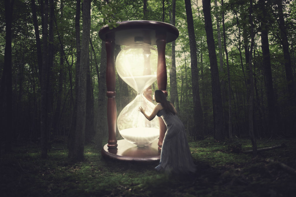 a woman finds a huge hourglass in the forest