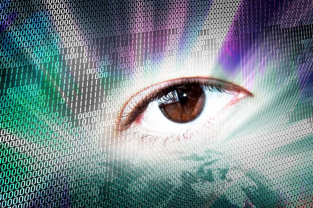 abstract digital montage of an eye and binary code SF9C O0Hj