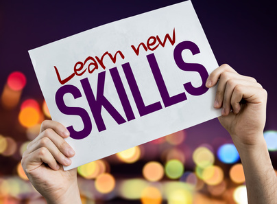 Learn New Skills placard with night lights on background